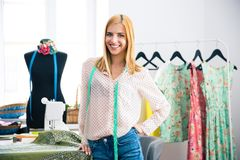 Female tailor standing in workshop Royalty Free Stock Image