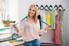 Female tailor standing in workshop a Royalty Free Stock Photos