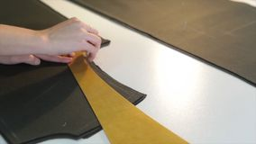 Tailor.Hands notch tailor tailor`s scissors cloth. Female tailor stitching material at workplace. Preparing fabric for royalty free stock photo