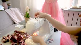 Female tailor working in her studio with sewing machine.