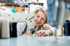 Female tailor working on sewing machine Royalty Free Stock Photos