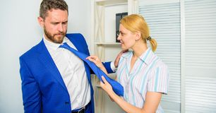 Female take sexual initiative. Office and sexual behavior. Woman hold mans necktie. Girl seduce colleague. Sexual. Harassment at workplace. Workforce sexual royalty free stock photography