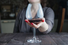 Female take wine glass Stock Image