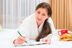 Female takes notes in a notebook Royalty Free Stock Photography