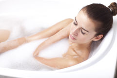 Female taking a bath. Beautyful brunette female taking a bath Royalty Free Stock Photos