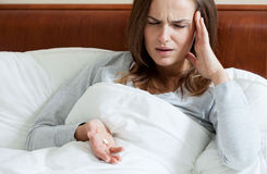 Female taking painkillers. Female having terrible headache taking painkillers Stock Photos