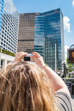 Female taking a picture of PricewaterhouseCoopers skyscraper, Vancouver Stock Photos