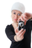Female taking pictures with a digital camera Stock Images