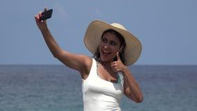 Female Taking Selfie At Ocean stock footage