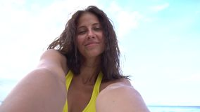 Female taking selfie using phone on beach smiling and spinning enjoying vacation stock video