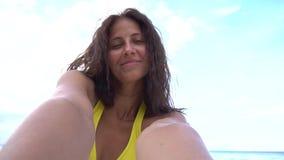 Female taking selfie using phone on beach smiling and spinning enjoying vacation. Female taking selfie using phone on beach smiling and spinning enjoying nature stock video