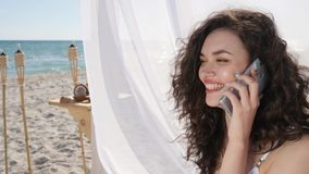 Female talking by mobile on embankment, summer vacation at tropical islands, phone call girl on beach ocean,. Laughing women called by smartphone, girl talking stock video footage