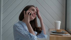 Female talking on a mobile phone. Cute female talking on the phone with her girlfriend stock video footage
