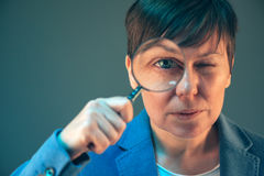 Female tax inspector with magnifying glass Stock Photography