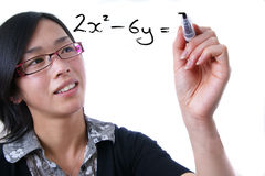 Female Teacher. Drawing a board Royalty Free Stock Photography
