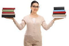 Female teacher with book stacks royalty free stock image