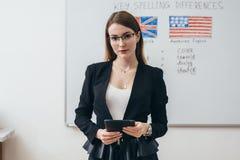 Female teacher in classroom English language school. stock images