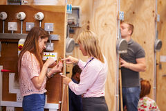 Female Teacher Helping Students Training To Be Electricians Royalty Free Stock Photos