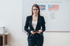 Female teacher looking at camera. English language school. stock photo