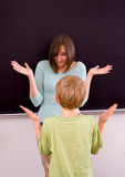 Female teacher and male student Royalty Free Stock Images