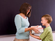 Female teacher and male student Stock Images