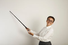 Female teacher with a pointer at white board stock image