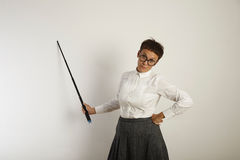 Female teacher with a pointer at white board stock photo