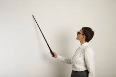 Female teacher with a pointer at white board royalty free stock photos