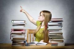 Female teacher pointing back Royalty Free Stock Image