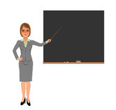 Female teacher pointing at blank blackboard with stick Royalty Free Stock Image