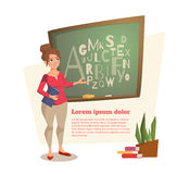 female teacher shows on the board where the letters are written Stock Image