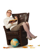 Female teacher sitting in armchair Stock Photography