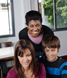 Female Teacher With Students In Classroom Royalty Free Stock Images