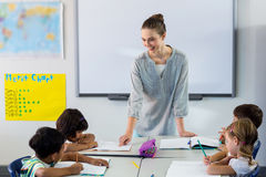 Female teacher teaching students Stock Photo