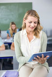 Female teacher using digital tablet in class Stock Image