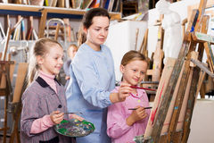 Female teachers assisting students Stock Photography