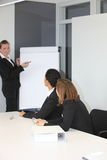 Female team leader giving a presentation Stock Images