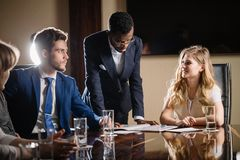 Female team leader talking with mixed race group of people in office. Female team leader talking with mixed race group of people on meeting in conference room Stock Images