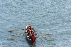 Female team on rowing boat at Clovelly, Devon Royalty Free Stock Photography