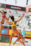 Female teams from USA jump in Country Quota. MOSCOW - JUNE 6: Female teams from USA jump in Country Quota at tournament Grand Slam of beach volleyball 2012, on Royalty Free Stock Images