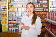 Female technician in chemist shop Royalty Free Stock Photos