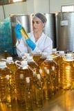 Female technician examining olive oil Stock Photography
