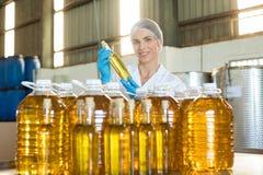 Female technician examining olive oil Stock Image