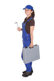 Female technician holding toolkit Stock Photos