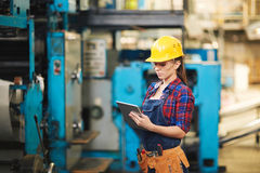 Female Technician Inspecting Machine royalty free stock images