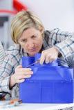 Female technician repairing fan. Female technician repairing a fan Stock Photography