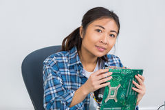 Female technician soldering mother board computor Royalty Free Stock Photos