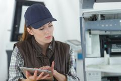 Female technician using tablet computer royalty free stock photo