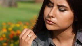 Female Teen And Apathy. A Young Hispanic Female Teen stock photo
