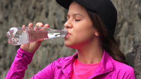 Female Teen Drinking Bottled Water Royalty Free Stock Photos